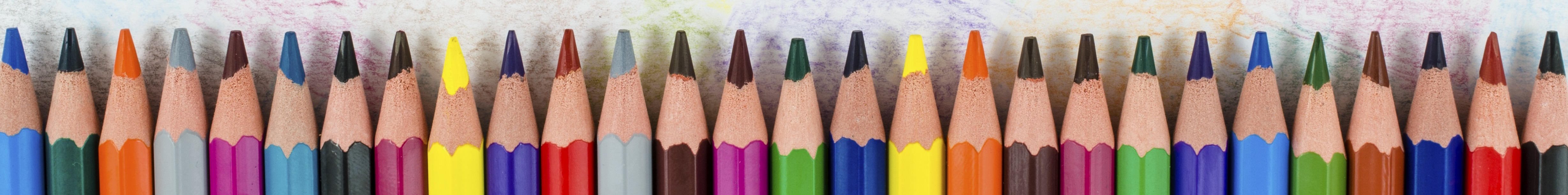 Color-pencils-in-a-row-with-colorful-background-000076289991_Full.jpg