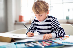 stock-photo-60209688-young-schoolboy-doing-his-homework.jpg