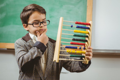 stock-photo-72354215-pupil-dressed-up-as-teacher-holding-abacus.jpg